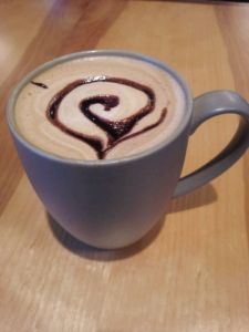 Mug of coffee/latte with chocolate swirl